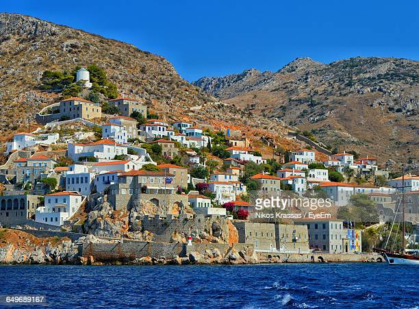 town by sea against sky at hydra island - hydra stock photos and pictures