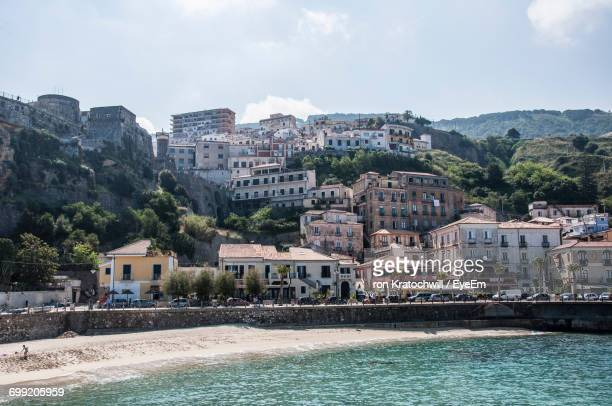 town by sea against sky - catania stock photos and pictures