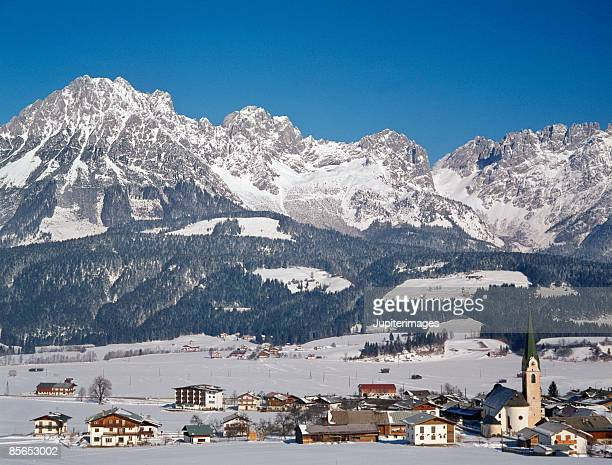 Town by snowy mountains , Tyrol , Austria