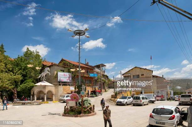 town center of güneykent on a sunny day,i̇sparta. - emreturanphoto stock pictures, royalty-free photos & images
