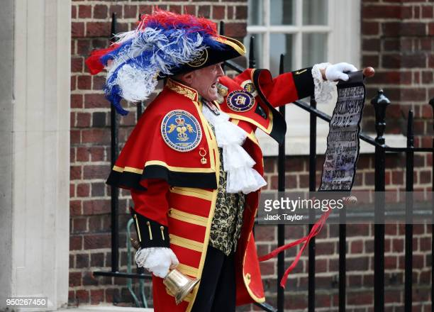 A town crier announces that the Duchess of Cambridge has given birth to a baby boy at St Mary's Hospital on April 23 2018 in London England The Duke...