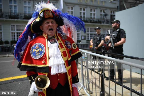 A town crier on the streets as armed police patrol near Windsor castle ahead of the royal wedding of Prince Harry and Meghan Markle on May 18 2018 in...