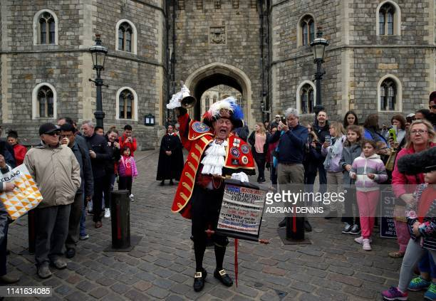 TOPSHOT Town crier Tony Appleton poses as he announces the birth of a son for Britain's Prince Harry and Duke of Sussex and his wife Meghan Duchess...