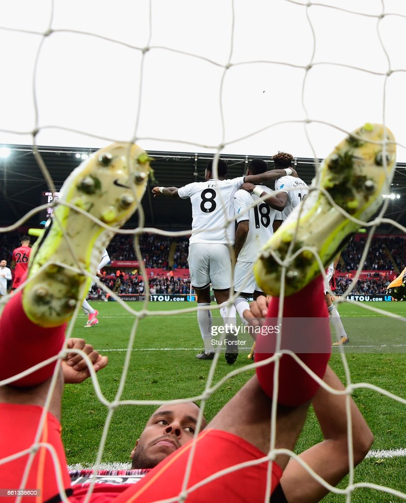 Town defender Zanka reacts as Swansea celebrate the second goal scored by Tammy Abraham during the Premier League match between Swansea City and Huddersfield Town at Liberty Stadium on October 14, 2017 in Swansea, Wales.