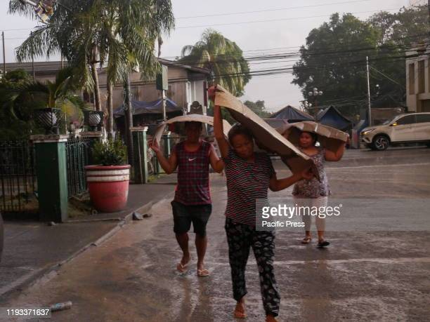 Town folks resorted in using thick cardboards to shield their heads while voluntarily fleeing their homes for safety since the ordinary umbrellas...
