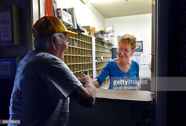 Town founder Nancy Kidwell greets a customer from the confines of the small post office inside her CalNevAri Casino in CalNevAri Nevada on May 15...