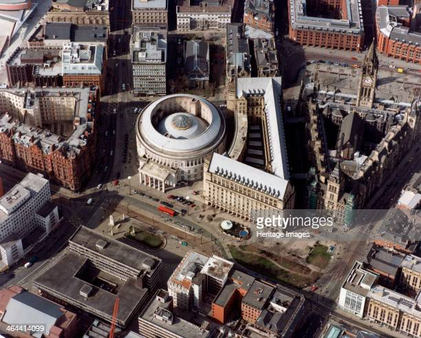 Town Hall and Central Library Manchester 2001 The town hall the triangular building with the tall clock tower was built in 1868 to designs by Alfred...