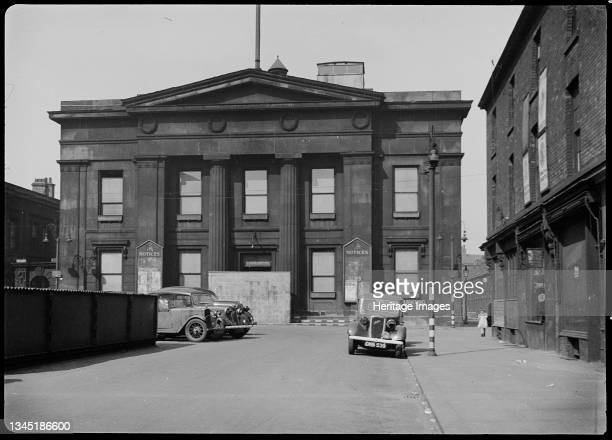 Town Hall, Bexley Square, Salford, 1942. An exterior view of the Town Hall, showing the south facade with two contemporary cars in the foreground....