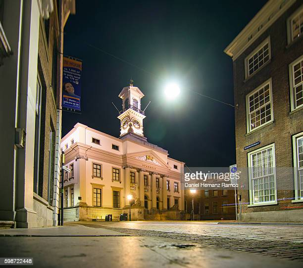Town hall in a empty street in Dordrecht at night. The Netherlands