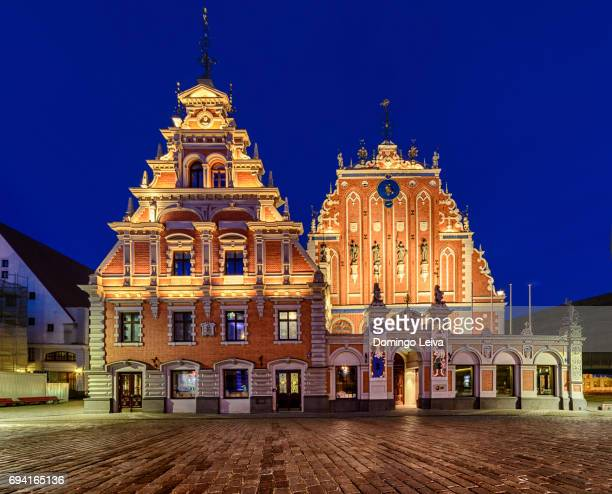 town hall square and house of blackheads at night, riga, latvia - house of blackheads stock photos and pictures
