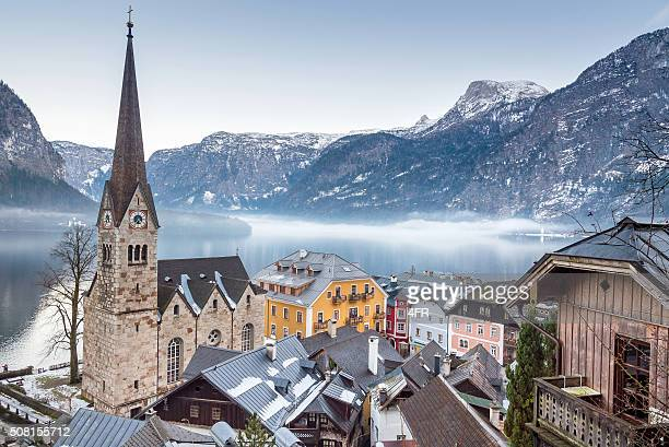 town hallstatt on a misty winter day - hallstatt stock pictures, royalty-free photos & images