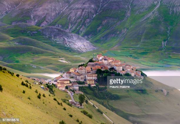 town in mountains, norcia, castelluccio, umbria, italy - castelluccio stock photos and pictures