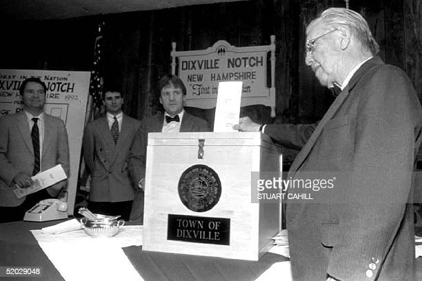 Town Moderator Neil Tillotson casts the first ballot in the US presidential election at midnight 03 November 1992 as the 30 voters of this village...