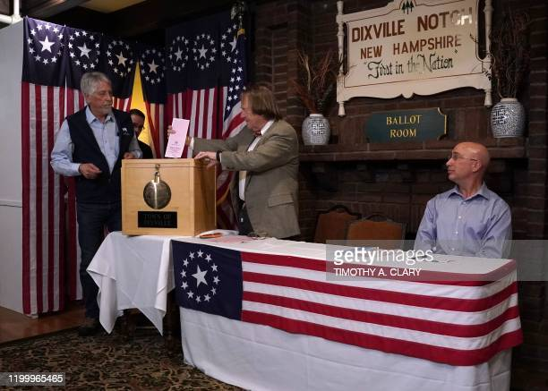Town moderator Tom Tillotson takes the ballot from Les Otten after midnight voting at the Hale House at the legendary Balsams Resort in the New...