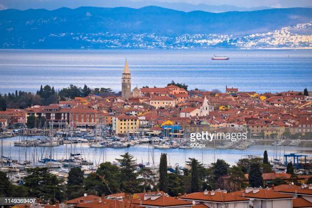 town of izola waterfront and bay aerial view - koper stock photos and pictures
