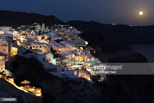 town of oia at night, santorini, greece - mini moon stock pictures, royalty-free photos & images