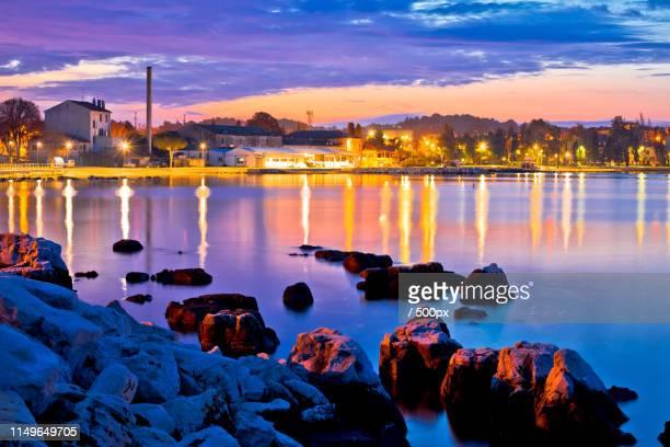 town of porec colorful dawn at coasline view - ユネスコ ストックフォトと画像