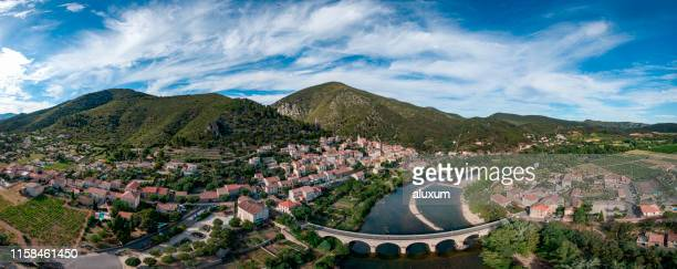 town of roquebrun in herault france - stone house stock pictures, royalty-free photos & images