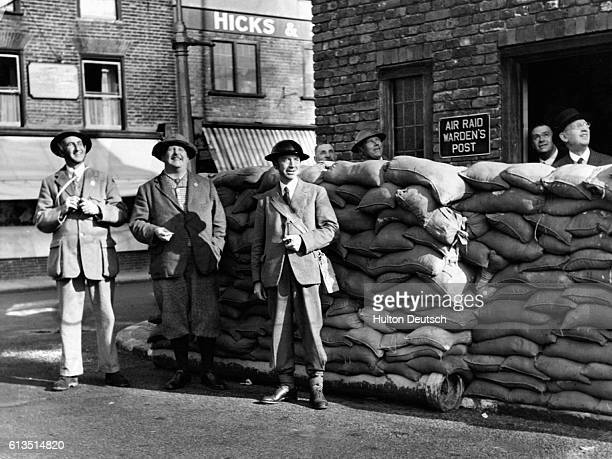 Town officials outside Sandwich town hall watch British planes fly overhead Left to right Mr RBH Harrison Chief Air Raid Warden Lt Colonel W Villiers...