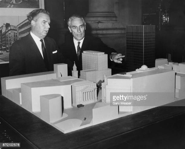 Town planner Lord Holford discusses plans for a new square near Bank Station in the City of London with City architect Edwin Chandler at the Royal...