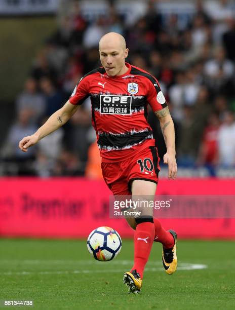 Town player Aaron Mooy in action during the Premier League match between Swansea City and Huddersfield Town at Liberty Stadium on October 14 2017 in...