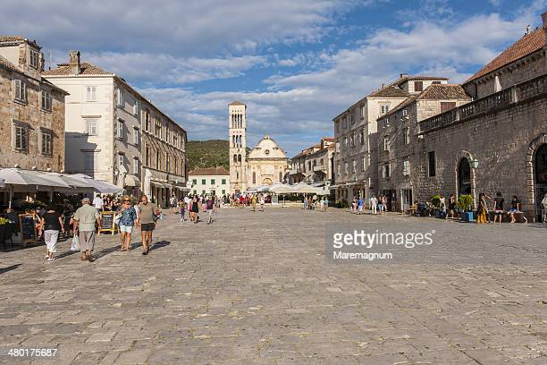 town square and st. stjepan cathedral - hvar stock photos and pictures