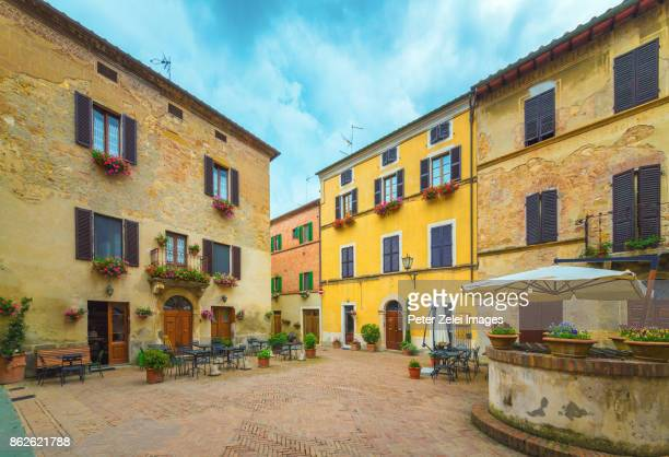 town square in italy with restaurant tables - siena italy stock photos and pictures