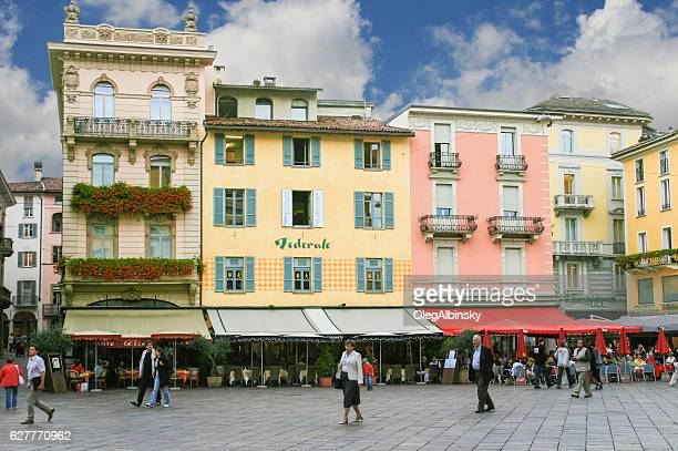 Town Square Lined with Restaurants and Colorful Houses, Lugano, Switzerland.