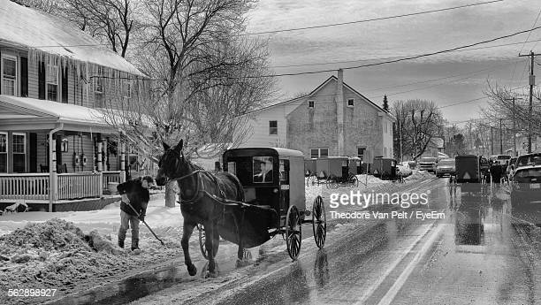 Town Street With Amish Buggies In Winter