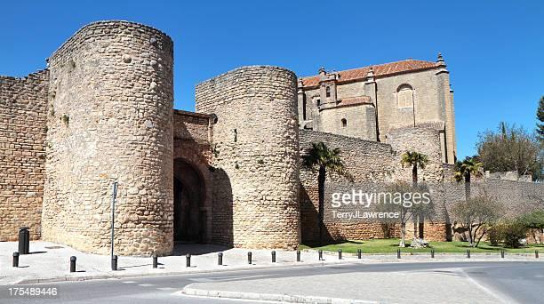 town walls and iglesia del espíritu santo, ronda, spain - ronda stock pictures, royalty-free photos & images