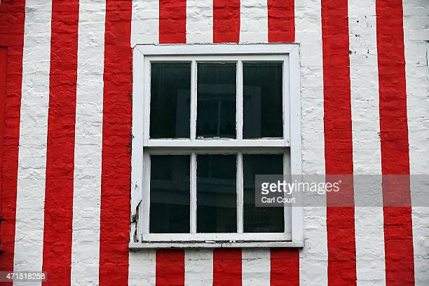 A townhouse that was painted in red and white stripes by its owner Zipporah LisleMainwaring after a planning dispute with her neighbours is pictured...