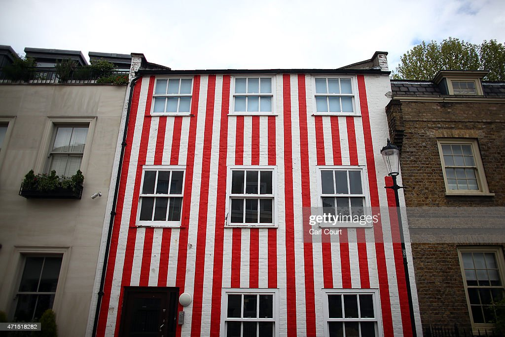 A townhouse that was painted in red and white stripes by its owner Zipporah Lisle-Mainwaring after a planning dispute with her neighbours is pictured on April 29, 2015 in London, England. Mrs Lisle-Mainwaring has since been ordered by the local council, the Royal Borough of Kensington and Chelsea, to paint it white and restore the window frames.