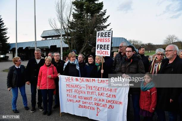 Townpeople demonstrate outside the Festhalle Bad Rotenfels hall for the freedom of the journalist Deniz Yuecel after a planned rally for expatriate...