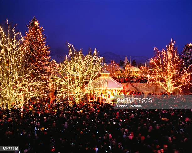 a town's tree lighting festival at christmas. - leavenworth washington stock photos and pictures