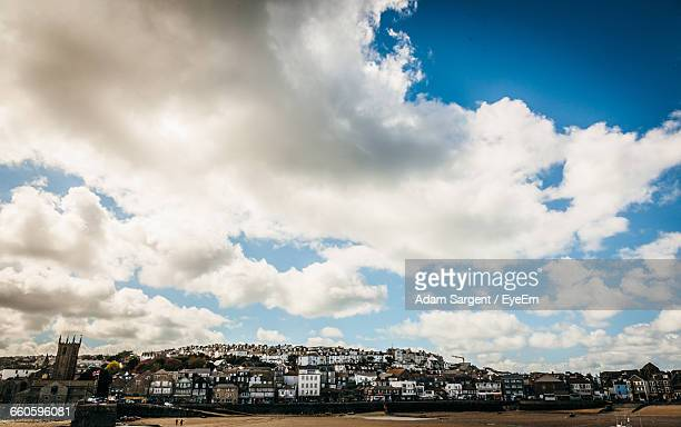 townscape against cloudy sky - st ives stock pictures, royalty-free photos & images