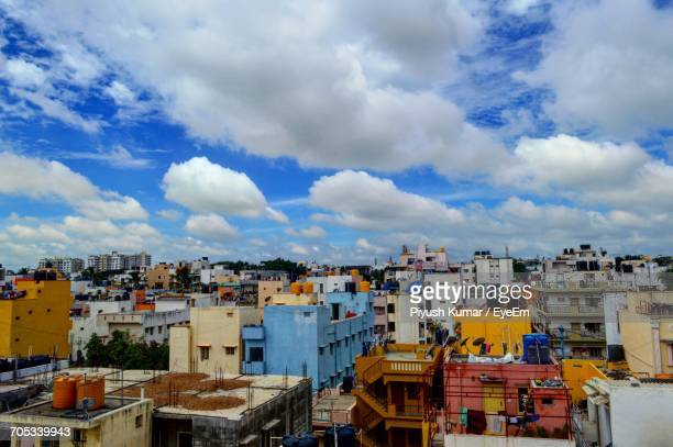 townscape against cloudy sky - bangalore stock pictures, royalty-free photos & images