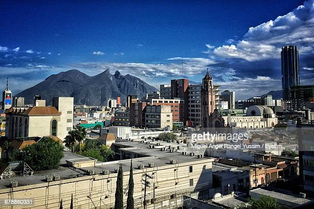 townscape by mountain against sky - monterrey stock pictures, royalty-free photos & images