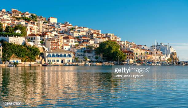 Townscape By Sea Against Clear Blue Sky