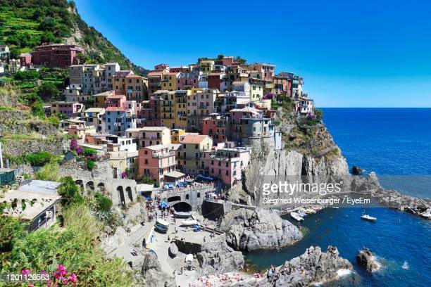 townscape by sea against clear blue sky - manila philippines stock pictures, royalty-free photos & images