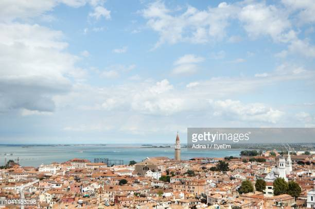 Townscape By Sea Against Sky