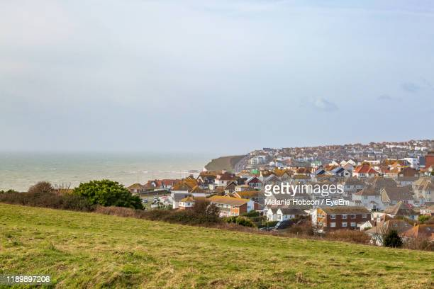townscape by sea against sky - saltdean stock pictures, royalty-free photos & images