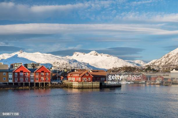Townscape Svolvaer, harbour, snow-covered mountains in the background, Austvagoey, Lofoten, Norway