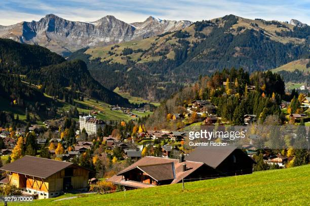 townscape with gstaad palace hotel in autumn, gstaad, bernese oberland, switzerland - グスタード ストックフォトと画像
