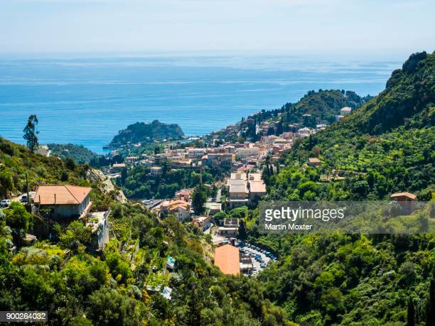 townscape with naxos bay, taormina, sicily, italy - naxos sicily stock pictures, royalty-free photos & images
