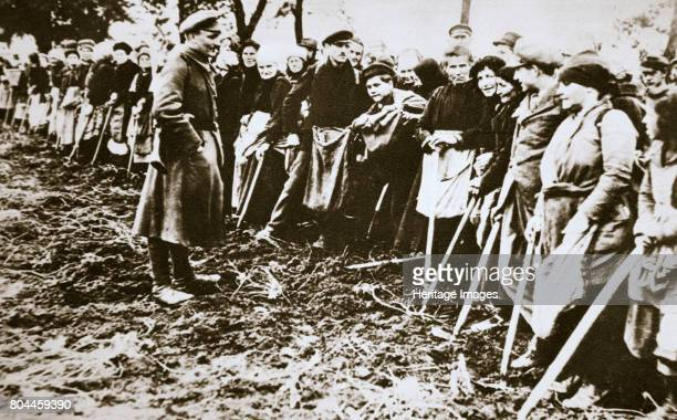 Townsfolk wait to scour the fields for potatoes left by farmers Germany World War I c1914c1918 About 750000 German civilians died from starvation as...