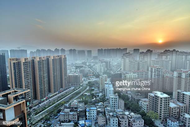 township have a bird's eye view of sunset - zhongshan stock-fotos und bilder