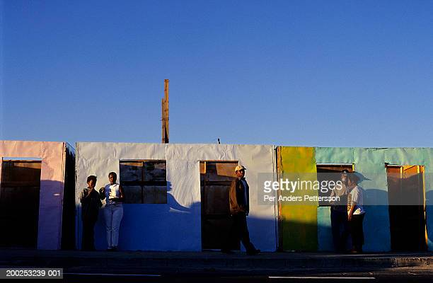 township residents walk on a road as the sun sets in khayeliltsh - 難民キャンプ ストックフォトと画像