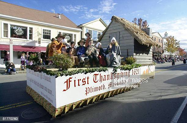 Townspeople dressed as pilgrims ride on a float during the annual Thanksgiving Parade November 20 2004 in Plymouth Massachusetts The parade part of a...