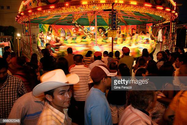 Townspeople line up to ride the modern and expensive Himalaya carnival ride at the annual Corn Fair on the streets of XaliscoThe corn fair is an...