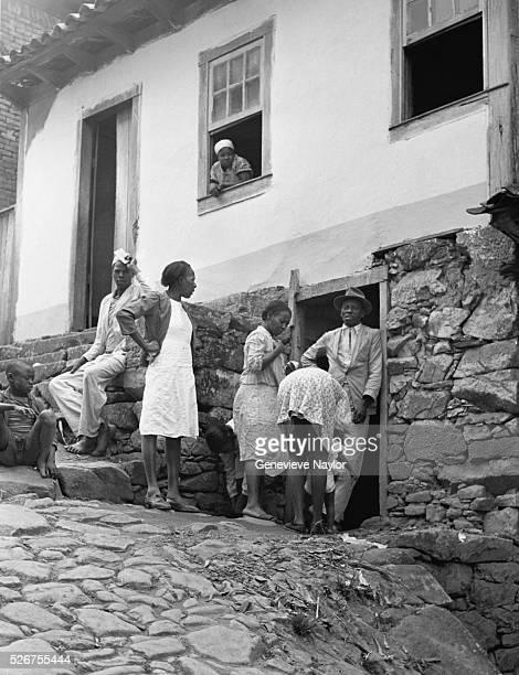 Townspeople Standing at Doorway